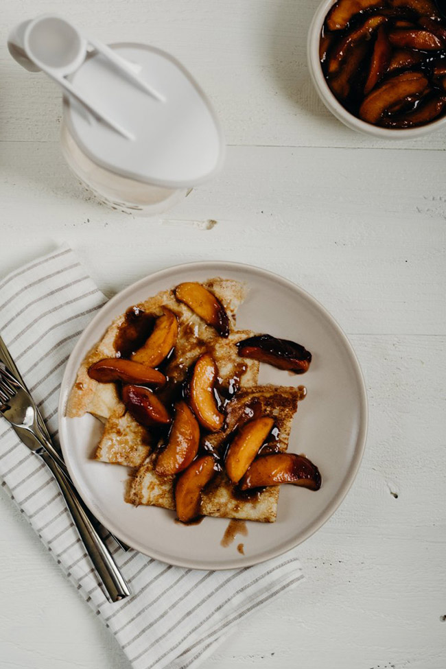 Crepes topped with caramelized peaches