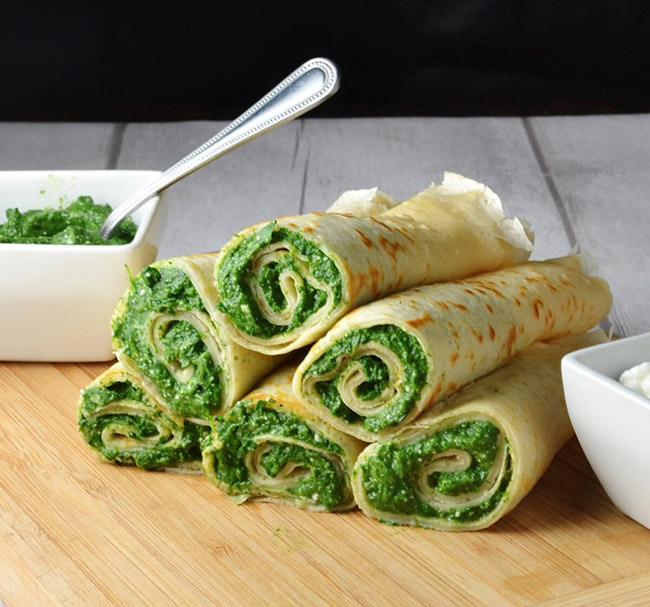 Crepes stuffed with spinach and cheese filling