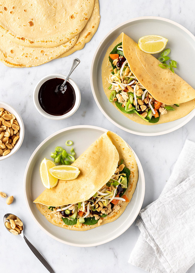 Vietnamese crepes stuffed with chicken, vegetables, and peanuts