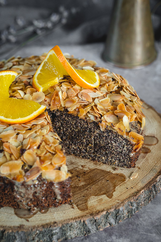 Almond poppy seed cake decorated with twisted orange slices