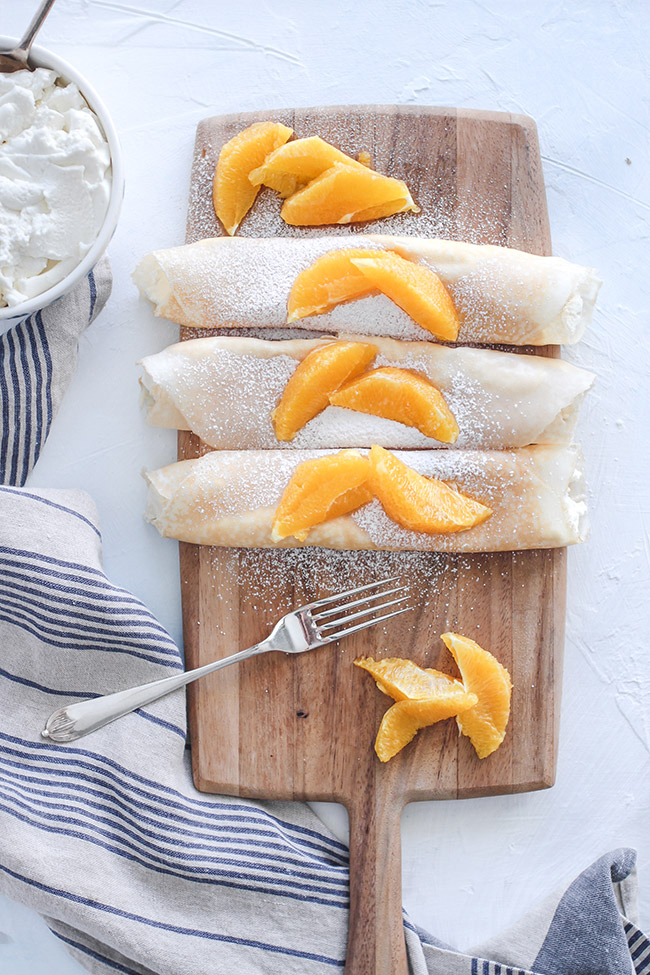 Ricotta crepes topped with orange slices