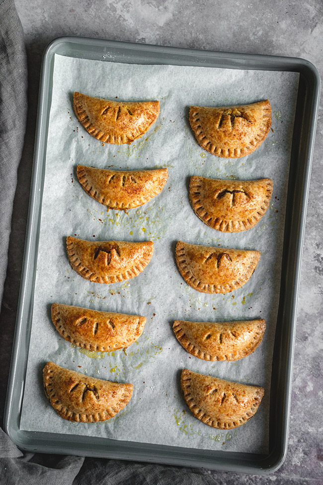 Pumpkin empanadas on a tray after baking