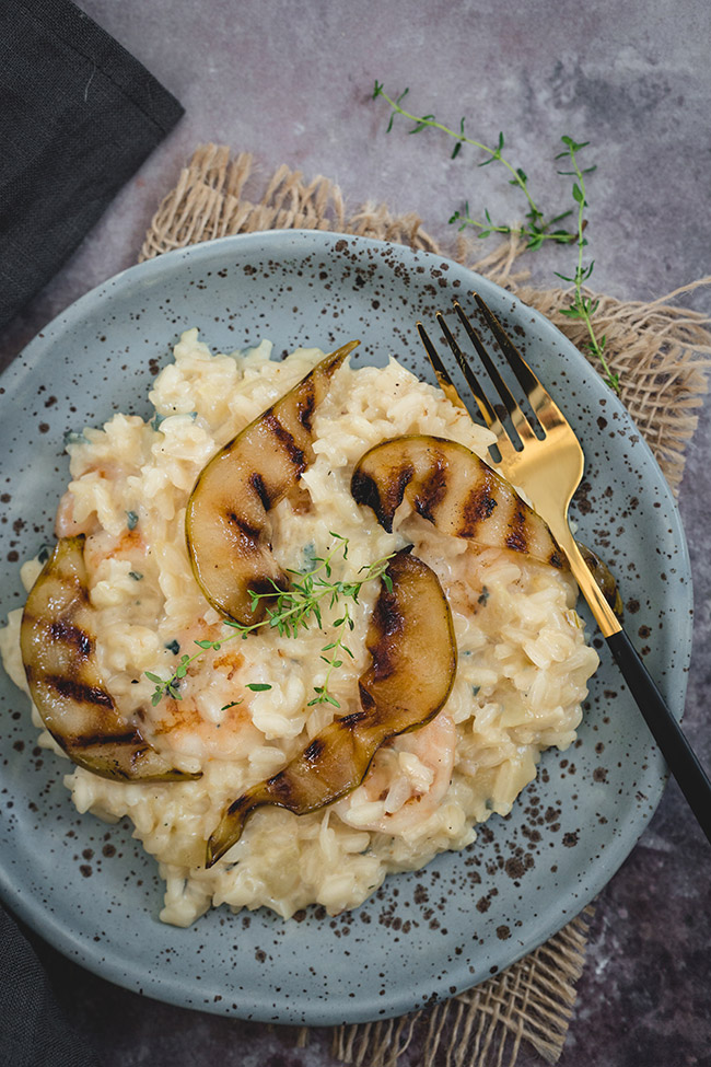 Risotto topped with pieces of caramelised pears