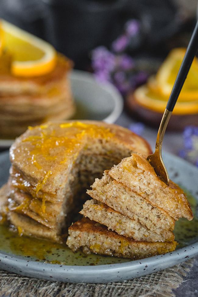 Taking a forkful of orange ricotta pancakes