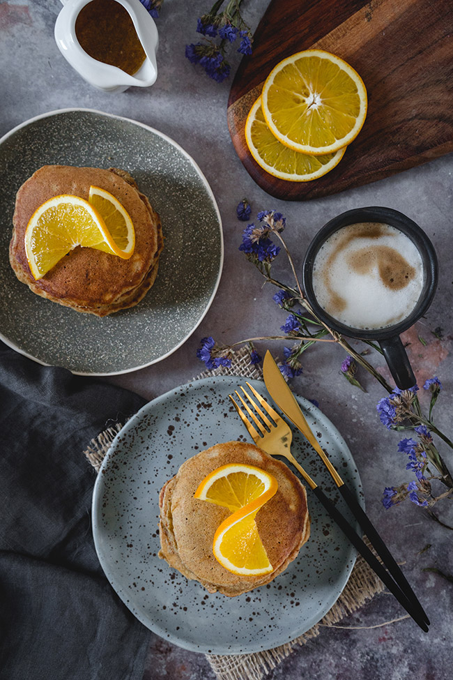 Plates of healthy ricotta pancakes