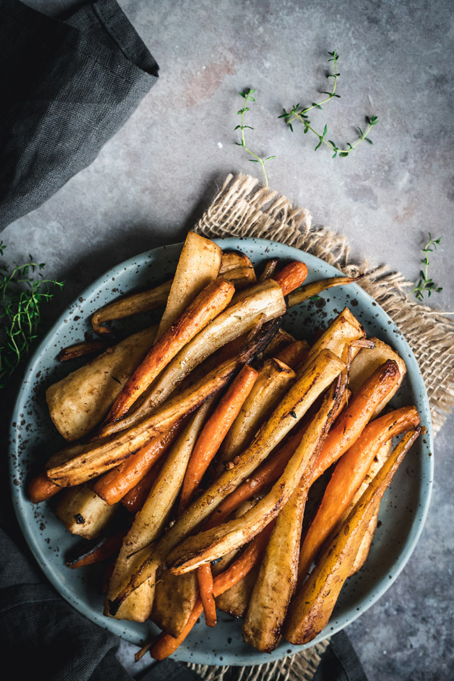 Plate of honey roasted parsnips and carrots with spices