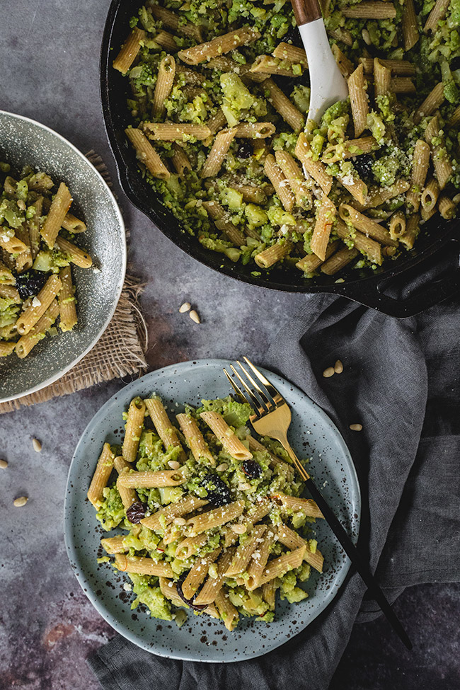 Plates and a pan full of easy healthy creamy pasta