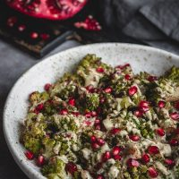 Romanesco side dish with tahini dressing and pomegranate seeds