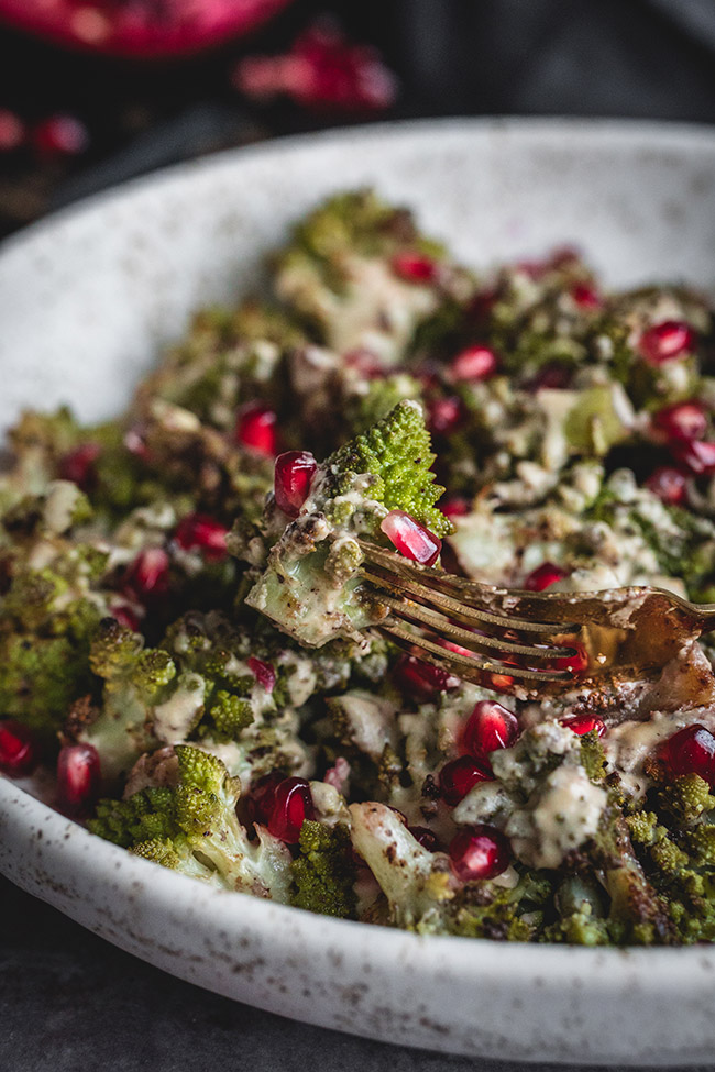 Taking a forkful of roasted romanesco