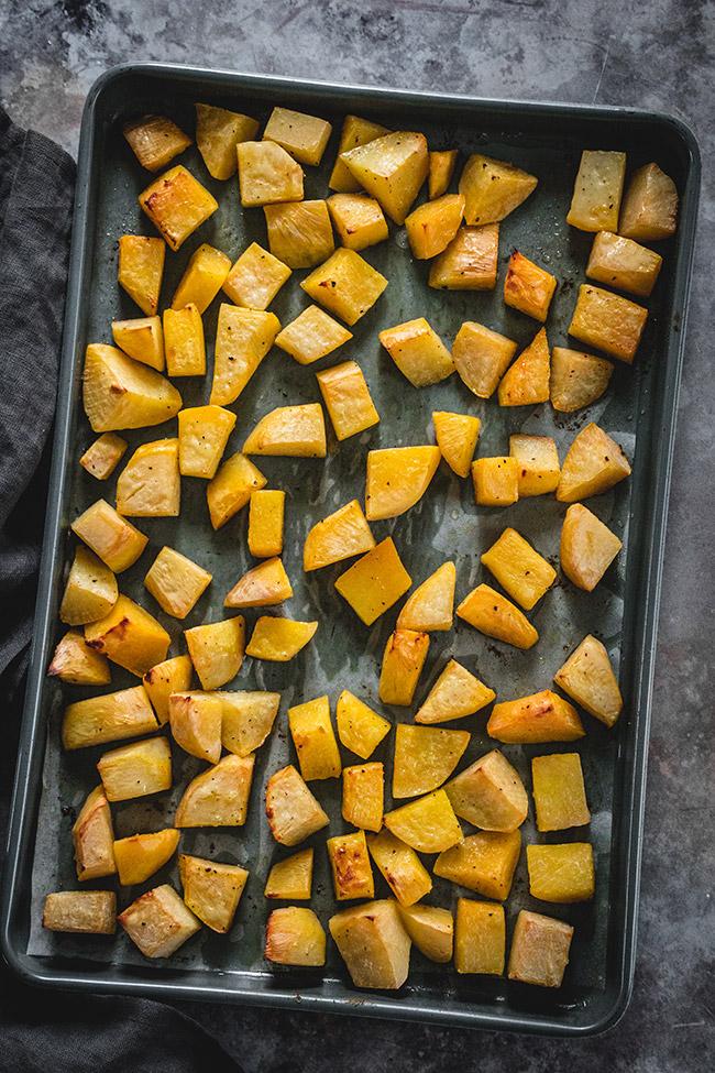 Roasting tray full of diced rutabaga
