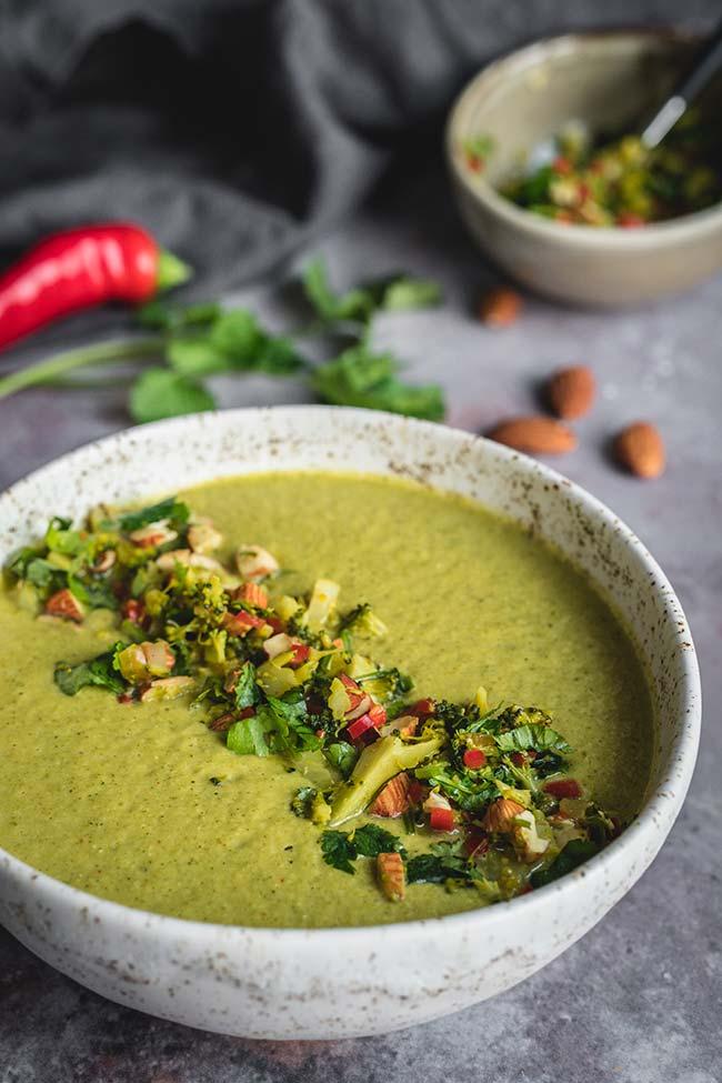 A bowl of creamy broccoli almond soup