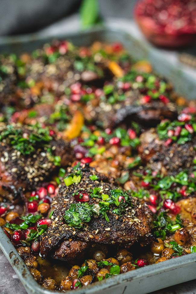 Pomegranate molasses marinated and za'atar spiced chicken thighs on a sheet pan