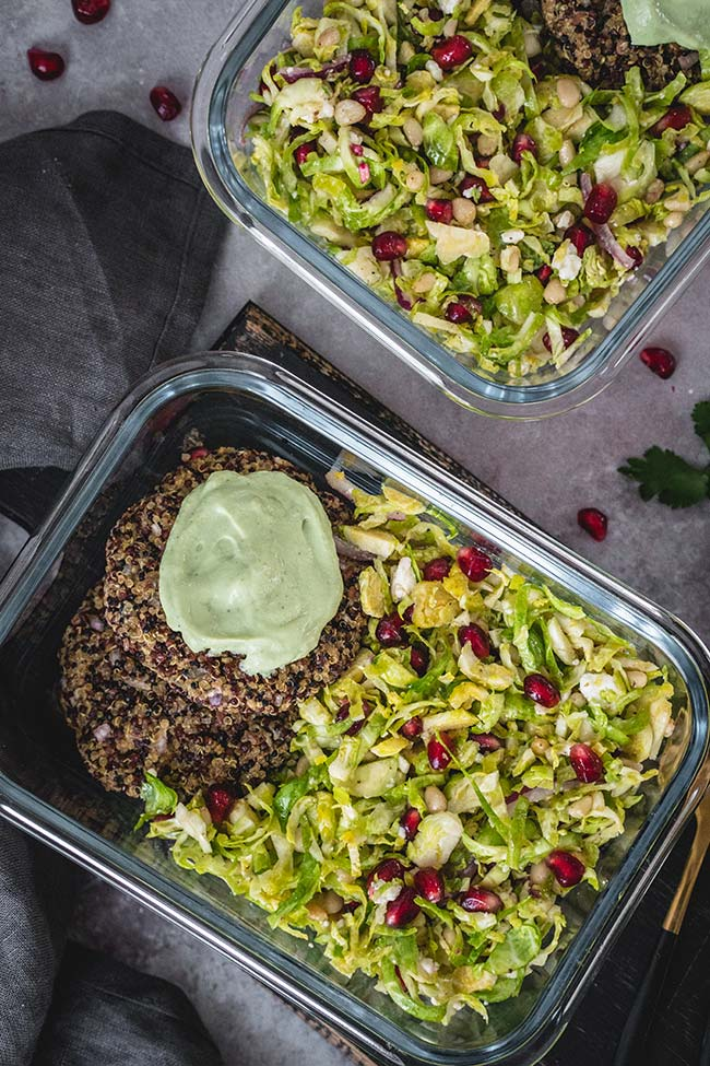 Baked quinoa patties with Brussels sprout pomegranate salad in a lunch box