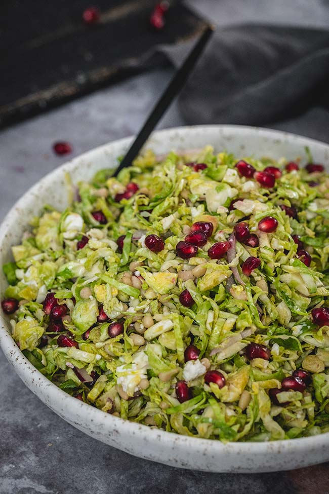 Shaved Brussels sprout and pomegranate salad in a bowl
