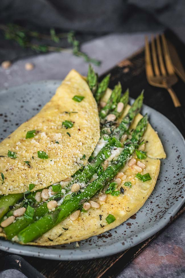 Folded asparagus omelette served on a plate
