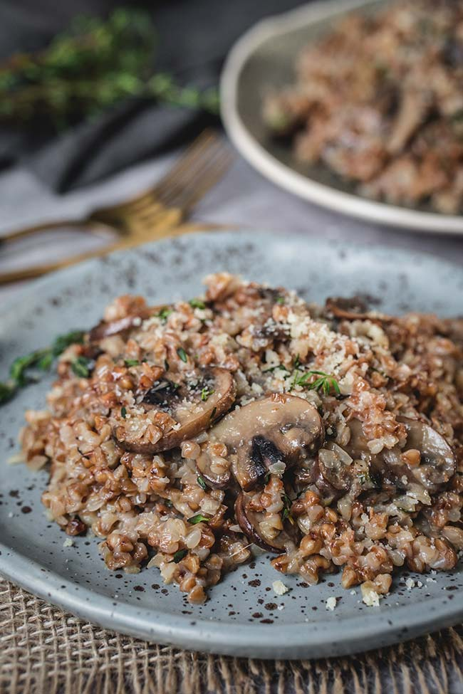 Buckwheat mushroom risotto served on a plate