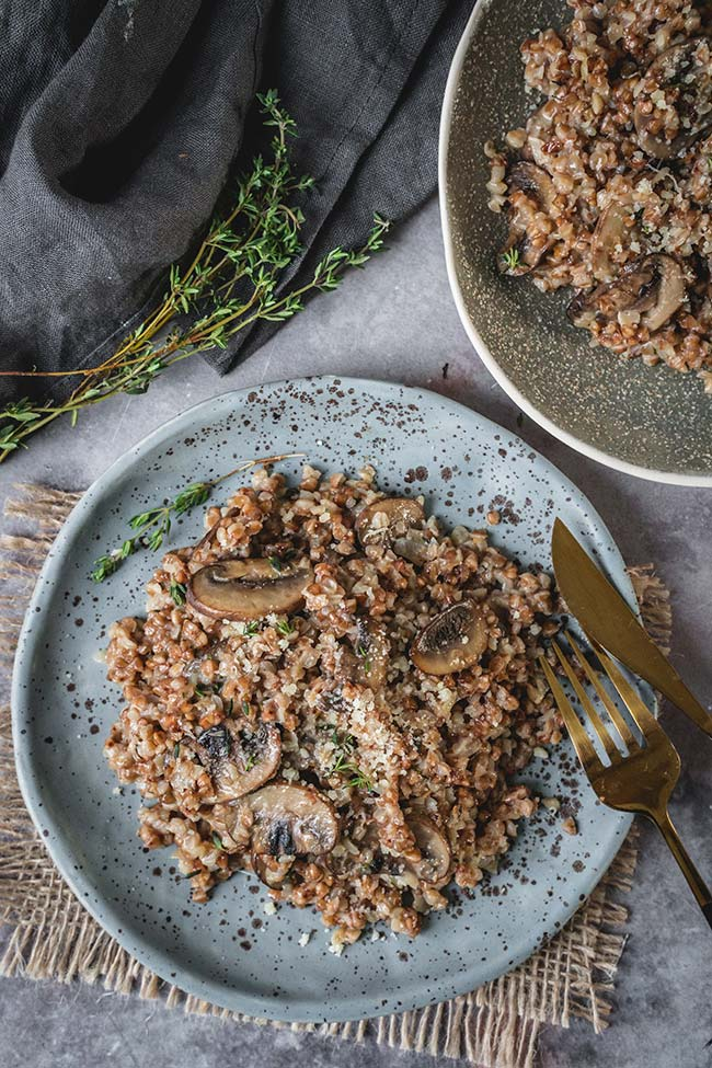 Buckwheat risotto with mushrooms sprinkled with fresh thyme