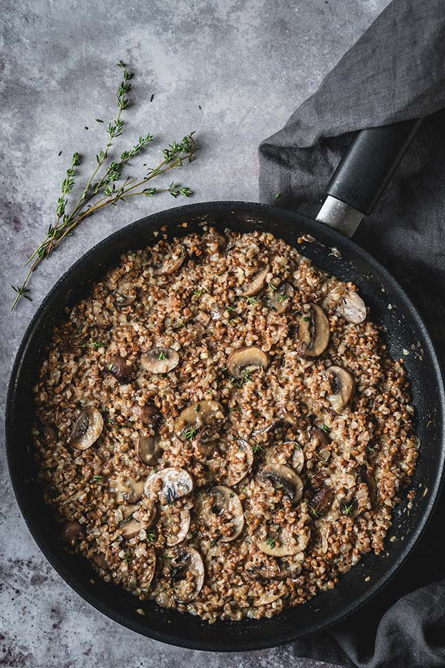 Buckwheat risotto in a skillet overhead shot