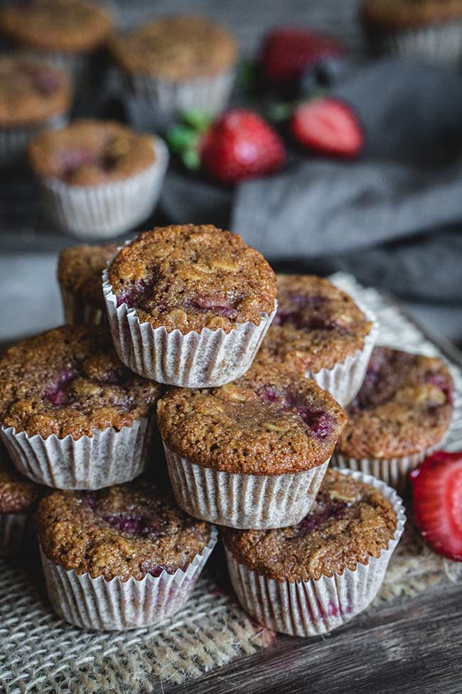 Healthy strawberry mini muffins stacked on top of each other