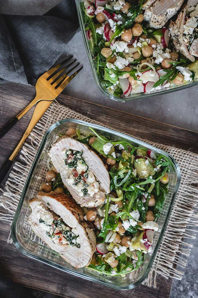 Spinach and feta stuffed chicken breasts with sun dried tomatoes in a lunch box