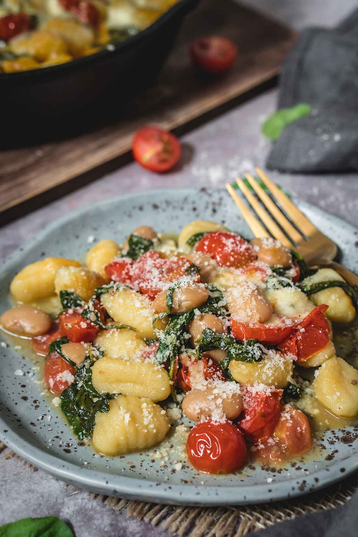Baked gnocchi with spinach served in a plate