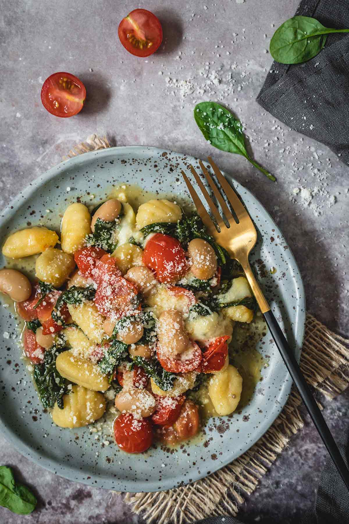 Gnocchi with spinach and tomatoes overhead shot