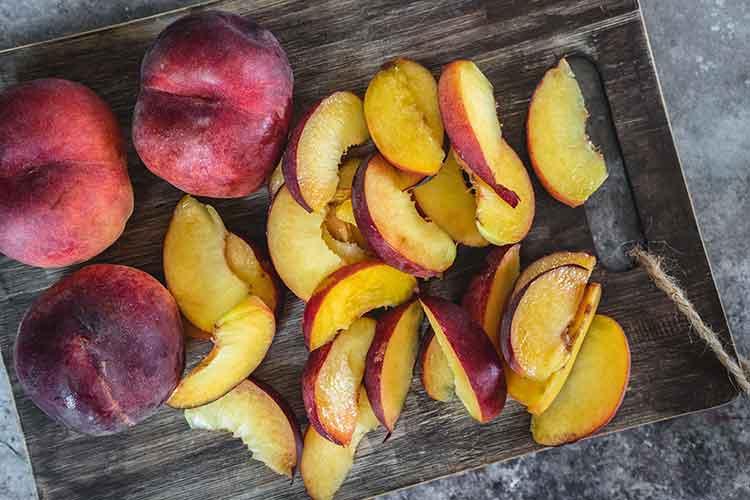 Sliced peaches on the table