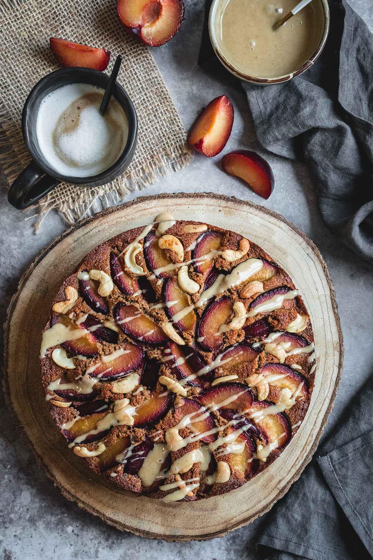 Healthy plum cake with lemon cashew icing