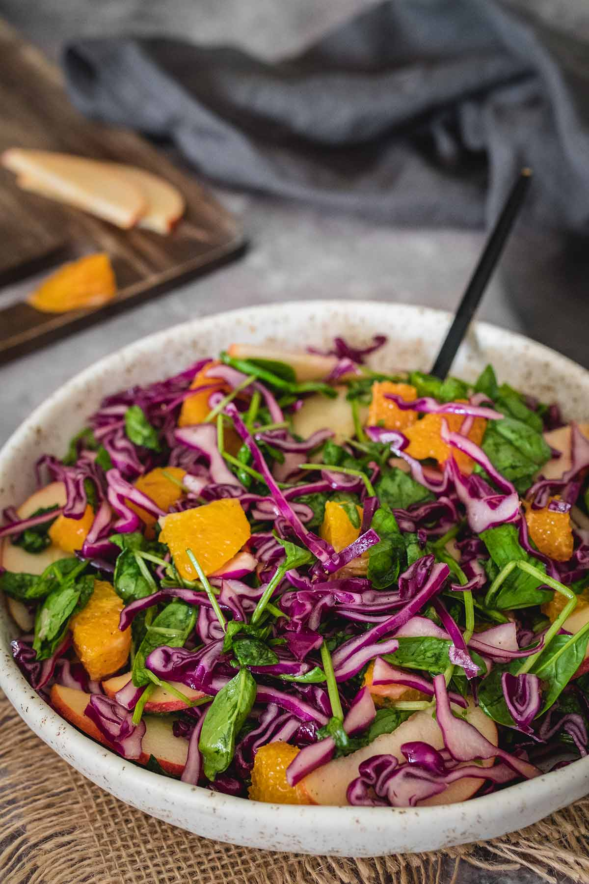 Red cabbage salad with orange, apple and spinach